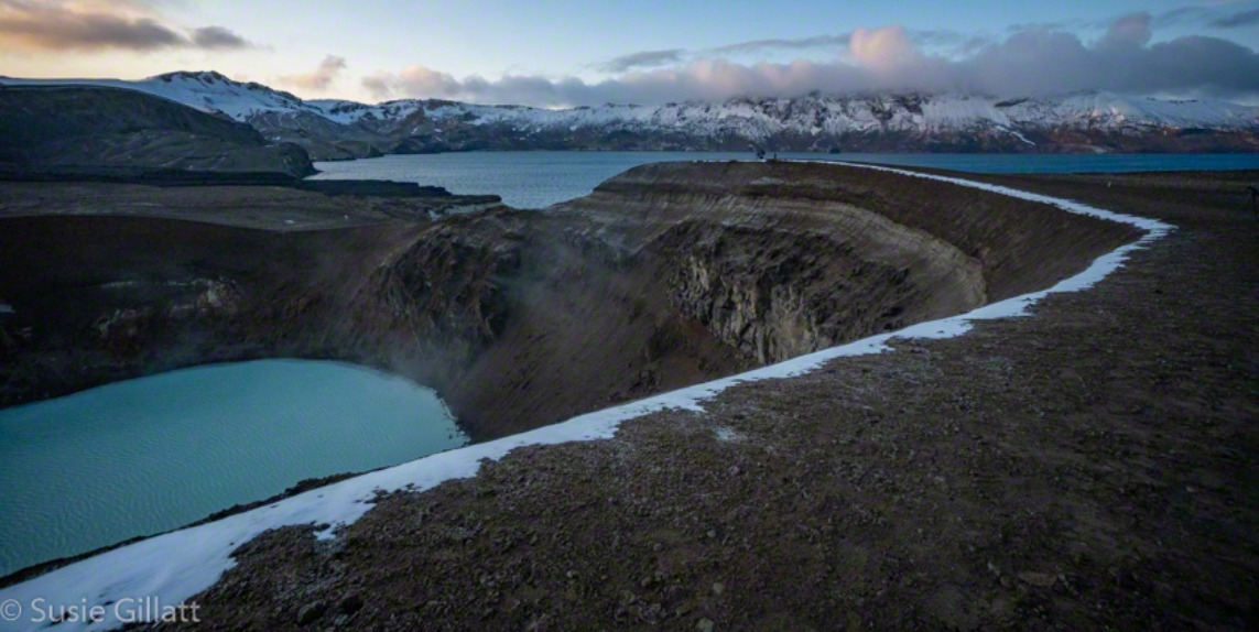 volcanic crater with a lake at sunrise