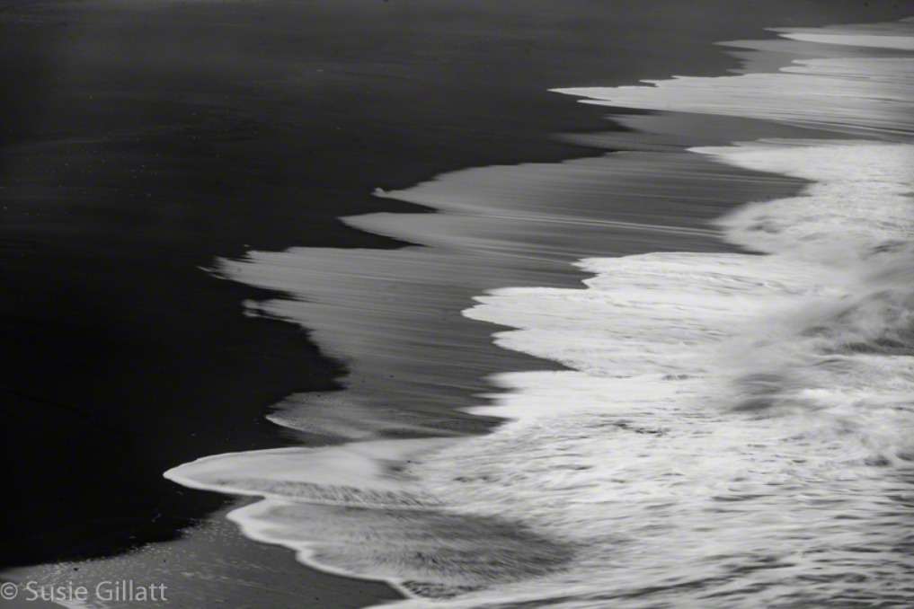 abstract black sand beach with waves