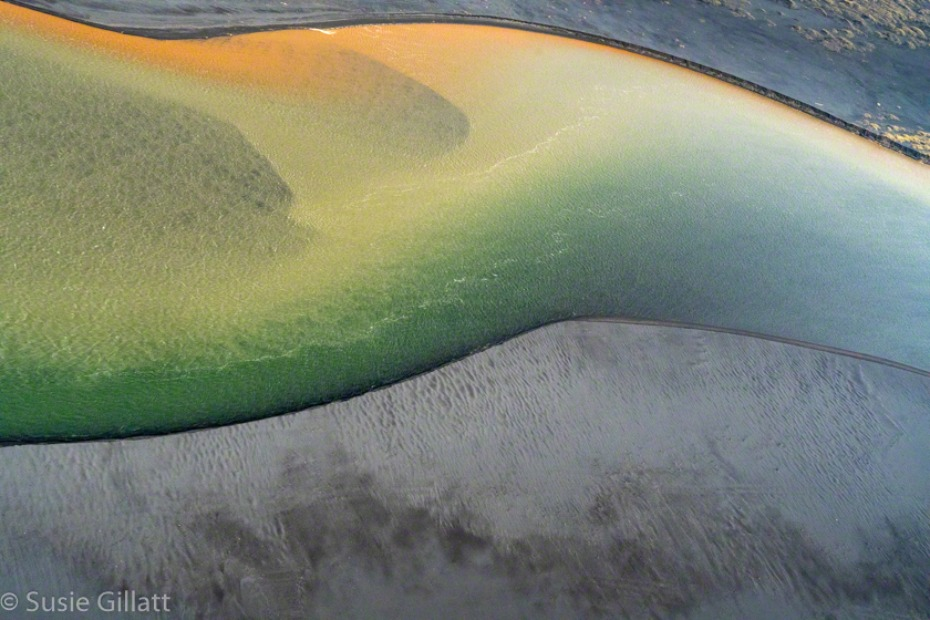 abstract aerial photo of rivers with colorful minerals